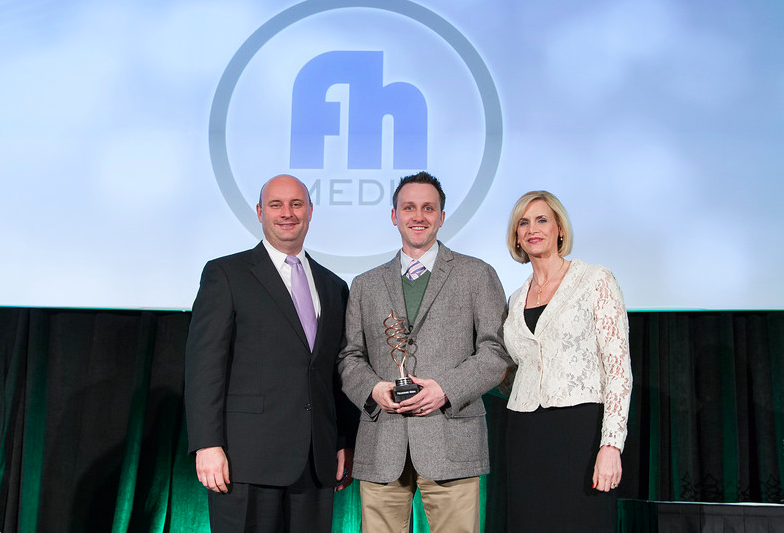 FIELDHOUSE MEDIA FOUNDER KEVIN DESHAZO ACCEPTS THE AWARD FOR INNOVATOR OF THE YEAR